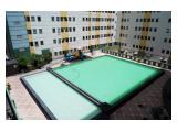 Homey 2BR Apartment at Puncak Permai with Pool View By Travelio