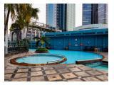 Elegant Minimalist 1BR Puri Imperium Apartment By Travelio